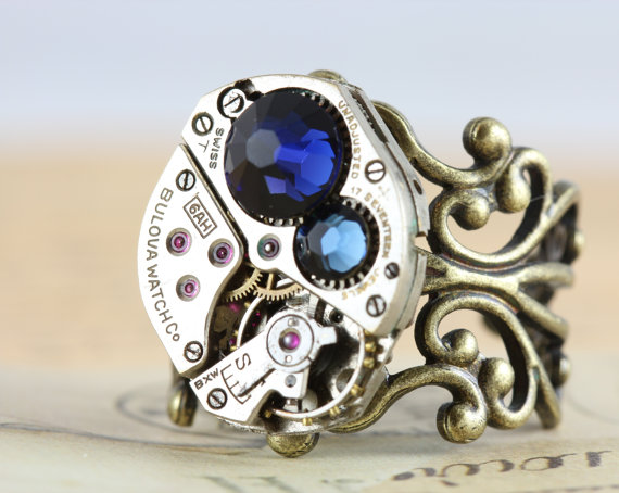 Steampunk Ring- Vintage watch movement. Swarovski crystals and adjustable antique brass ring.